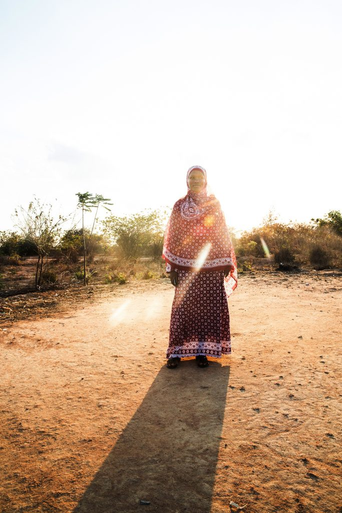 A woman named Hanifa stands in front of the sunlight