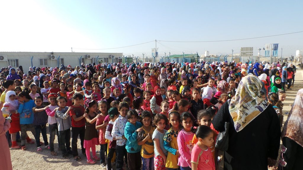 Syrian schoolchildren line up for assembly in the Zaatari refugee camp in Jordan.