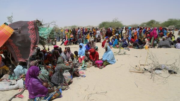 Thousands of people, mainly women and children, gather in the arid land of Nguigimi, Niger after fleeing Boko Haram violence in Nigeria.