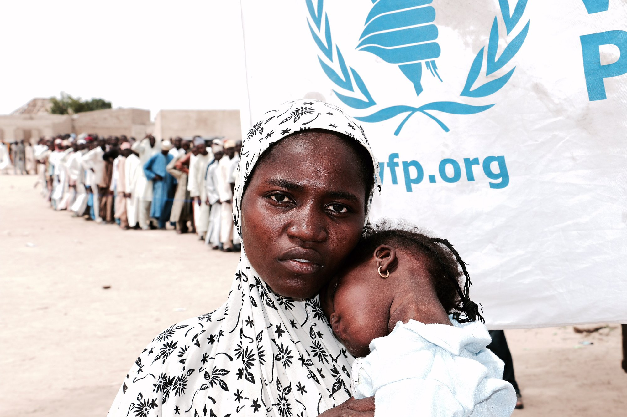 This mother in Maiduguri, Nigeria is among tens of thousands of displaced people who rely on monthly cash assistance of roughly $12 per month from WFP to feed her child.