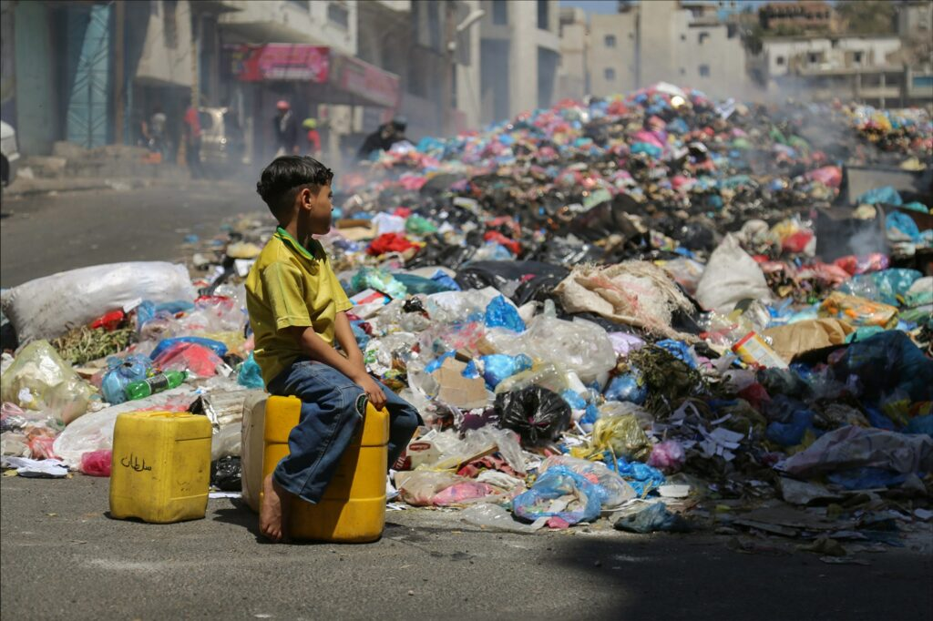People under siege inside Taiz city pile and burn their garbage on a main road after access to the garbage dump on the outskirts of the city was blocked due to the ongoing fighting.