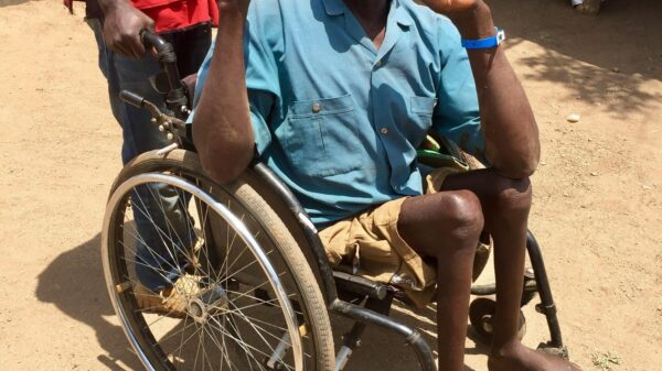 Jombo sits in a wheelchair in a refugee settlement in Uganda