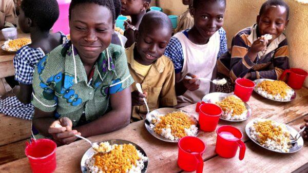 Children enjoy school meals in the classroom
