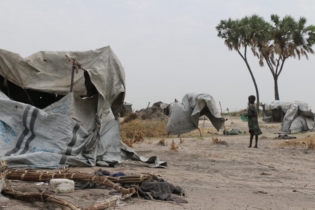 Children play around the makeshift tents they use as shelters for sleeping in Loth Village, South Sudan.