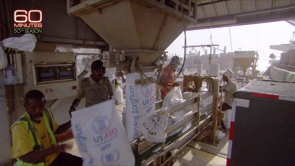 WFP and USAID bags of sorghum are filled