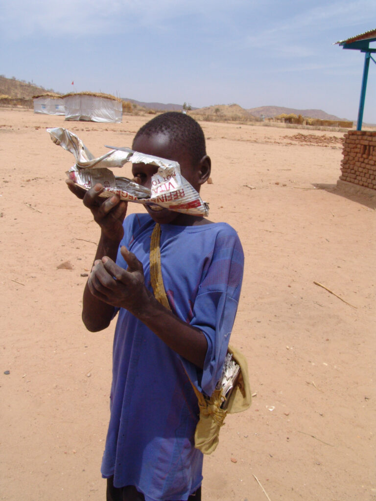 A boy at the Koubigou IDP camp in Chad shows the toy he made from various materials.