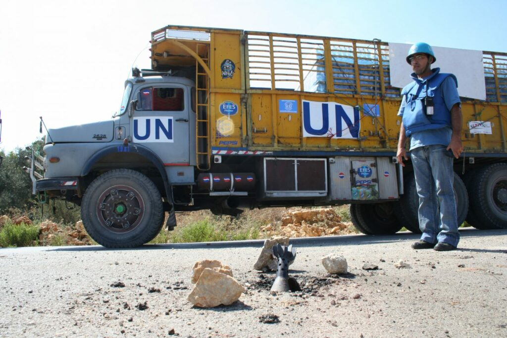 UN WFP Trucks transporting food encounter dangers