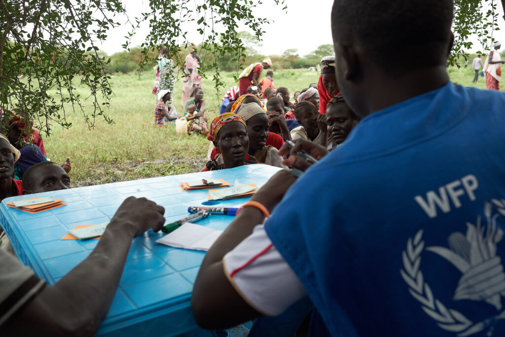 A WFP Field Monitor conducts registration for families in need of emergency food assistance in Buot village, South Sudan.