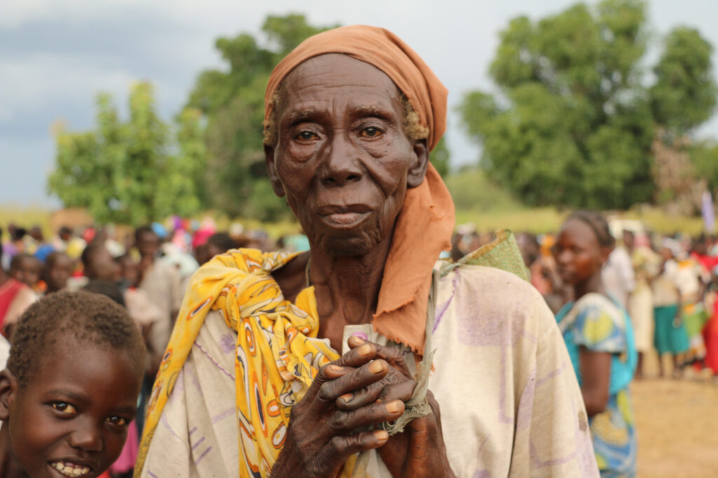 A woman awaits food rations from WFP in Farajallah, South Sudan.