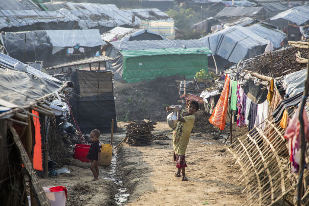 A child carries water in the Kutupalong settlement in Cox's Bazar, Bangladesh, which has become the largest and most densely population refugee camp in the world.