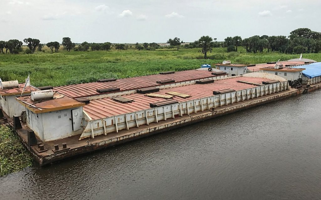 A barge carrying 2,250 metric tons of mixed commodities arrives in Malakal, South Sudan.