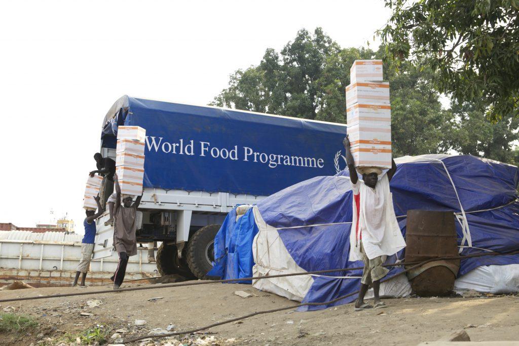 Volunteers unload humanitarian supplies in Juba, South Sudan.