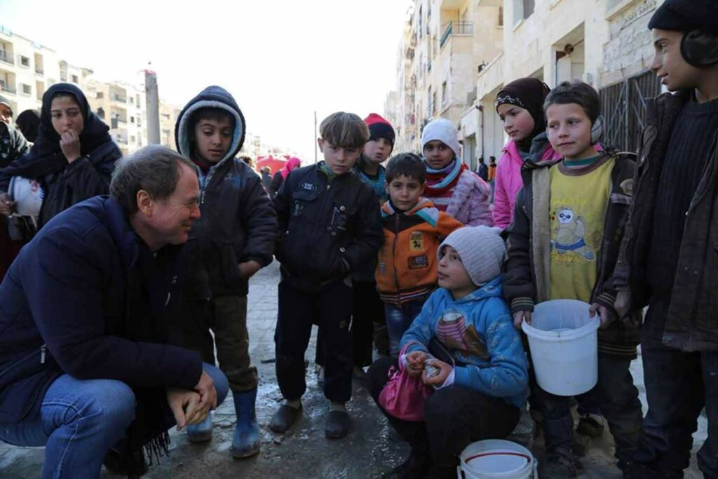 WFP's Country Director in Syria, Jacob Kern, talks with Syrian children in Aleppo as formerly displaced families began returning to the city.