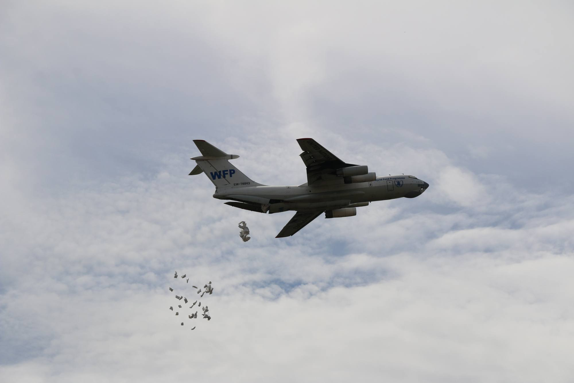 A WFP Ilyushin 76 releases food assistance over a drop zone in Ganyiel, Unity State.