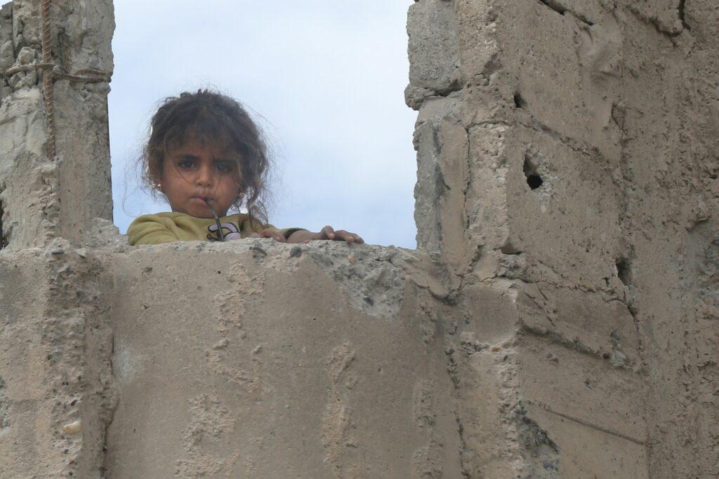 a young girl in broken building