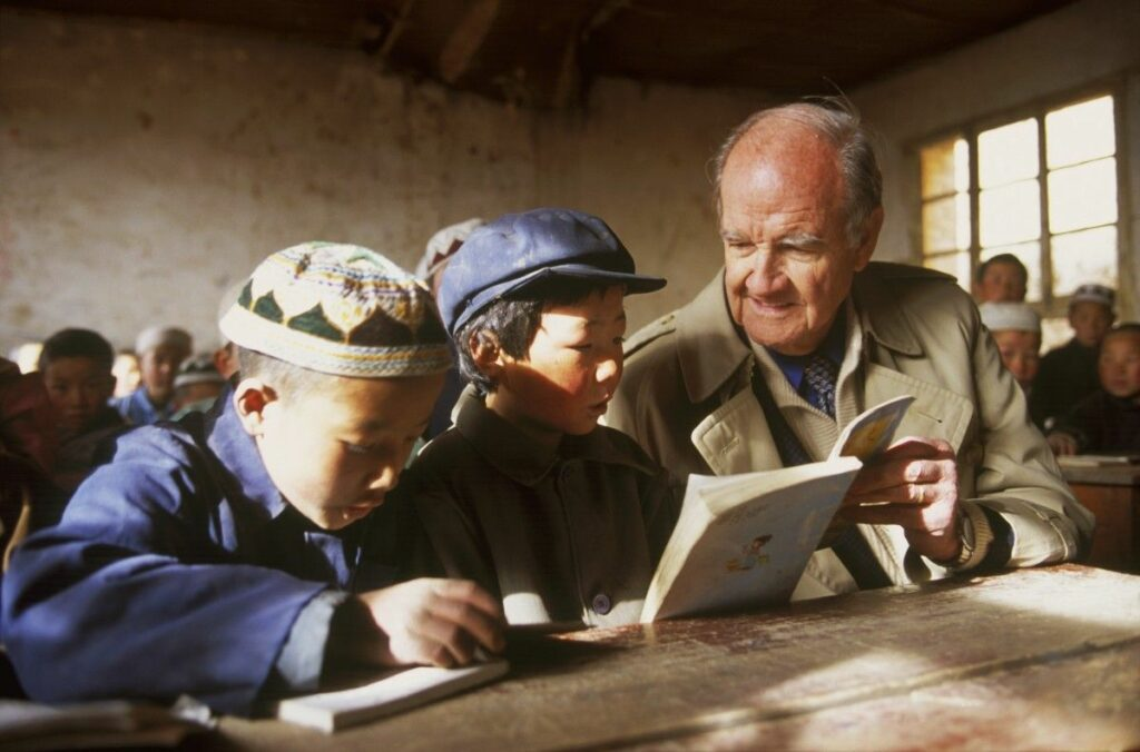 George McGovern reads with students in a rural Chinese primary school.