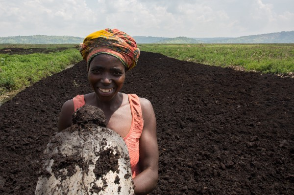 Farmer Clementine Uwamahoro stands in her field.