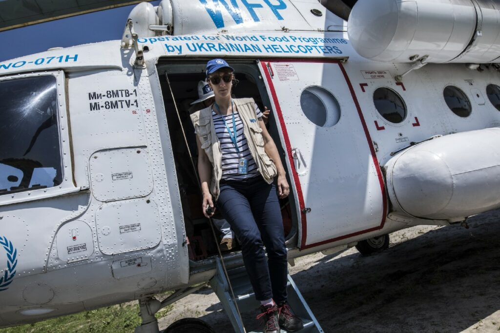 Lara Atanasijevic, WFP Access Officer, disembarks from an UNHAS helicopter in Katdalok.