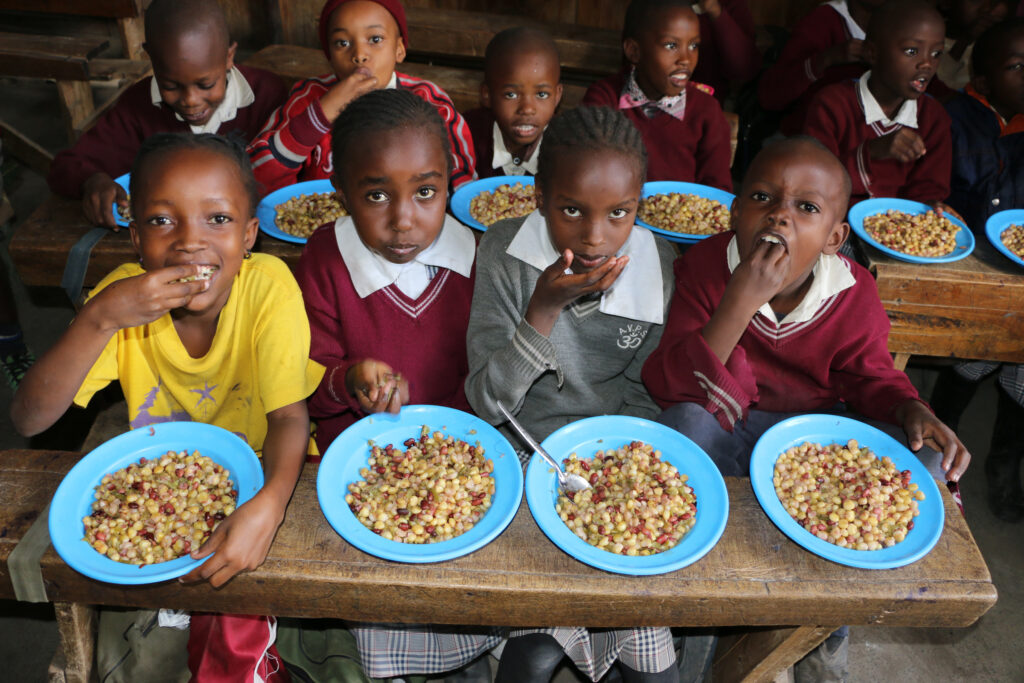 School children enjoy a lunch made with salvaged vegetables.