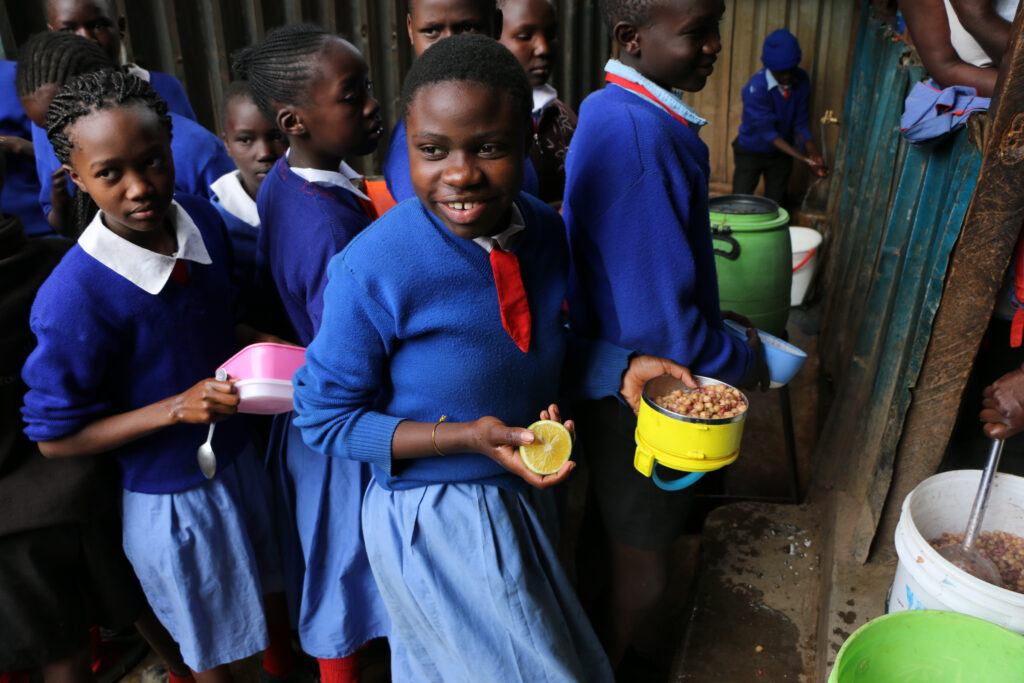Students collect their lunch in Nairobi.