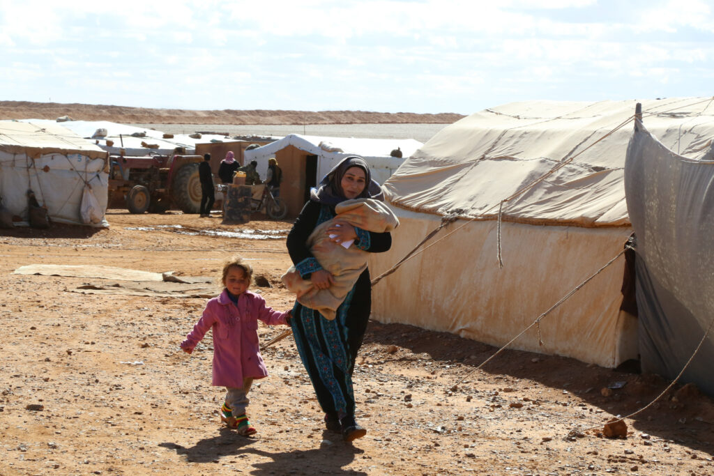 A woman and her two daughters at a refugee camp in Syria