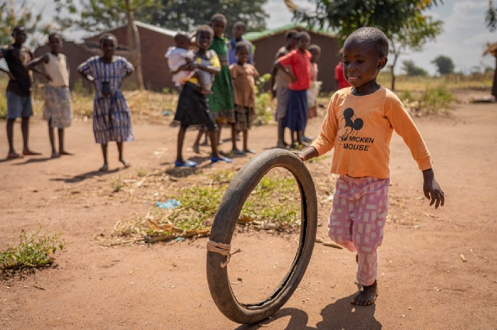young boy plays with toy in malawi
