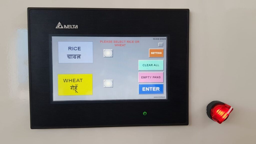 A small digital screen shows buttons that read: rice, wheat, clear all, empty pans and enter.