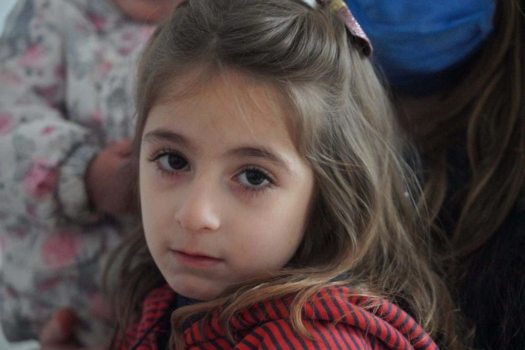 a young girl with a bow in her hair