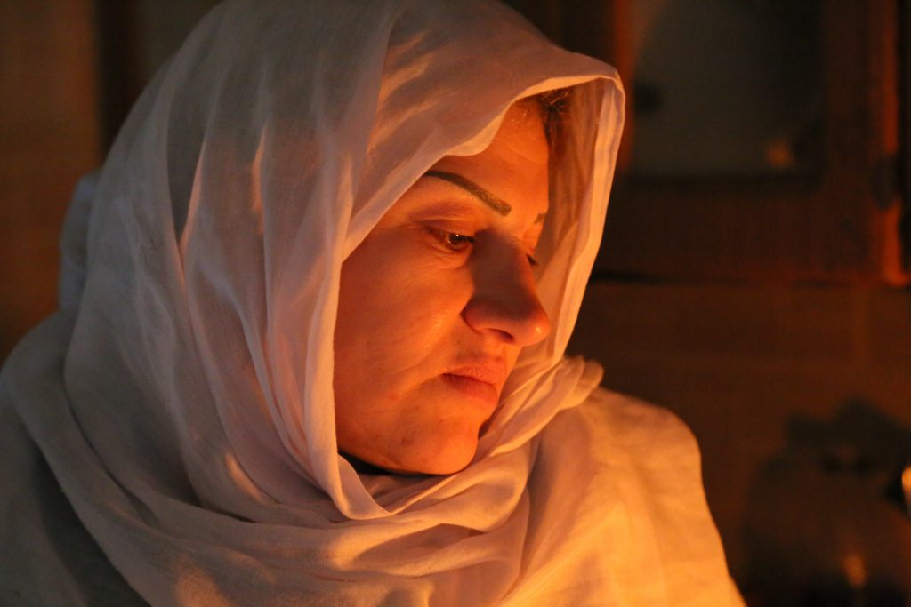 a woman in white headscarf
