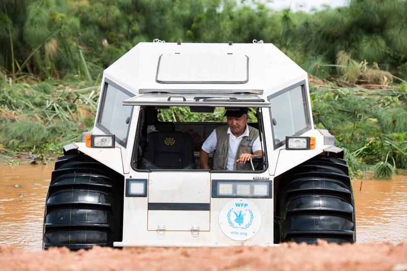 WFP all-terrain vehicle drives through muddy water