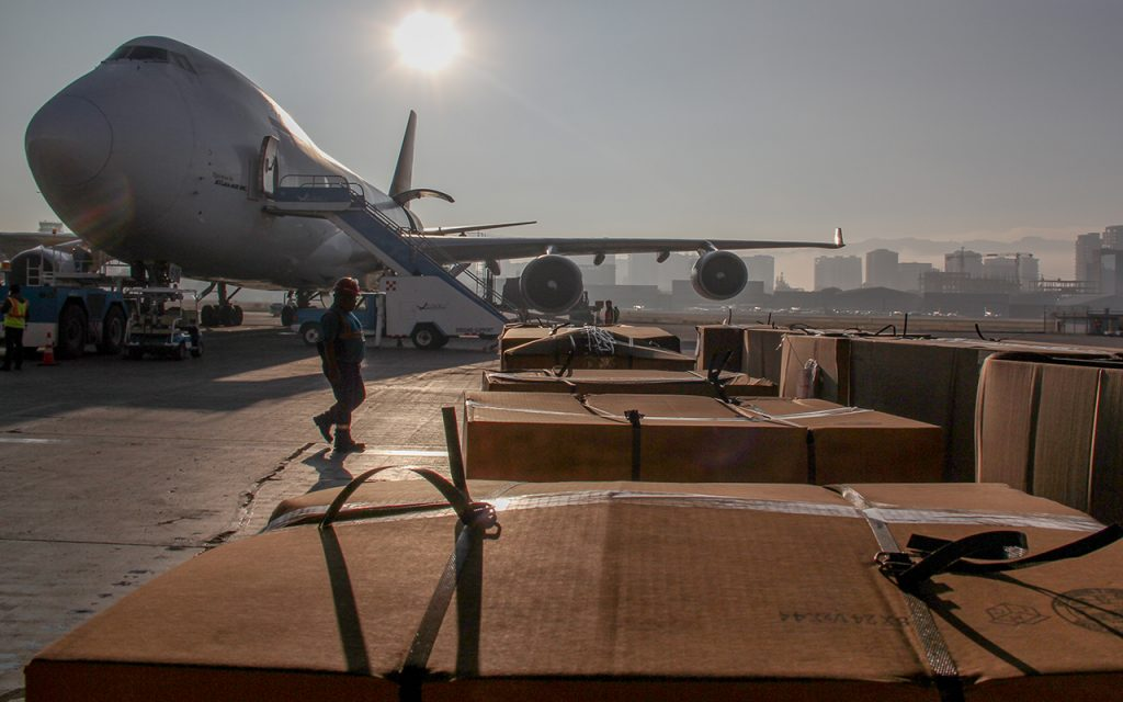 a plane waits on a tarmac