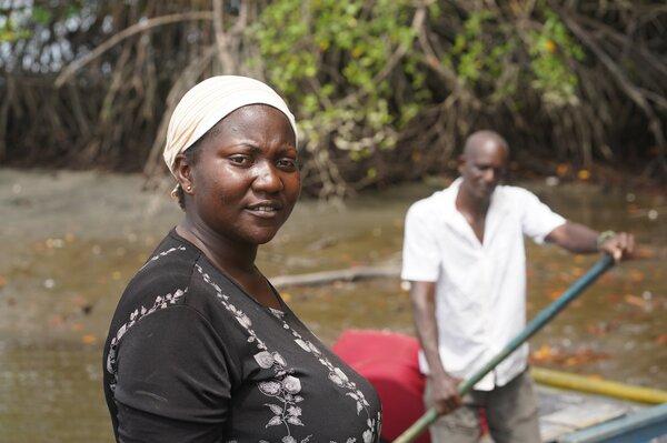fisherwoman standing in river