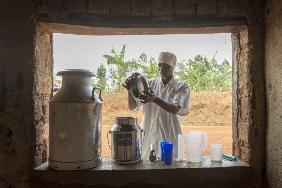 man inspects jug of milk
