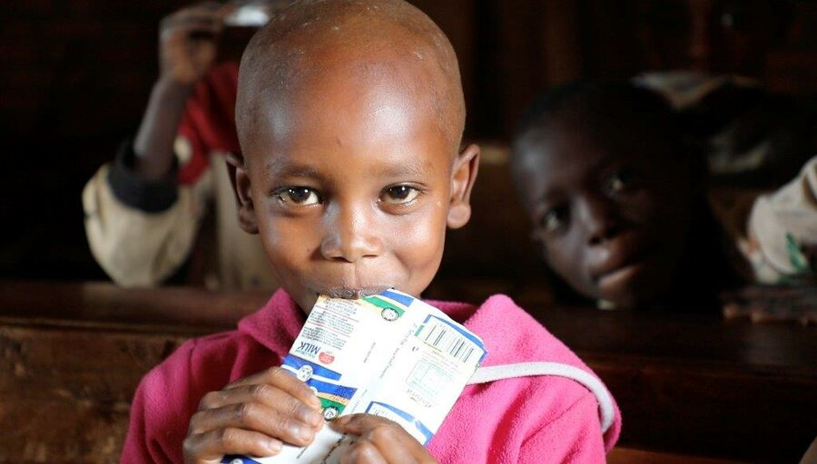 young girl eating nutrition bar