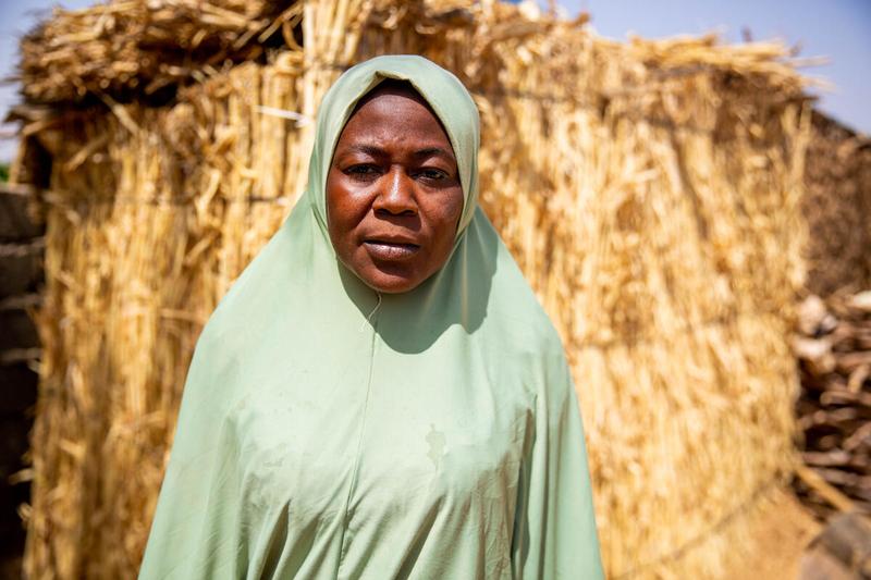 woman in light green headscarf