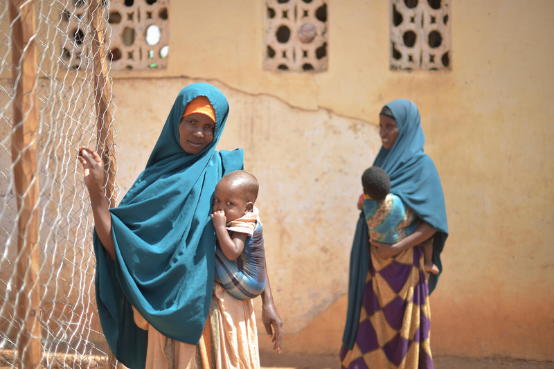 Women holding children in a UN WFP center for malnutrition in a refugee camp in Somalia