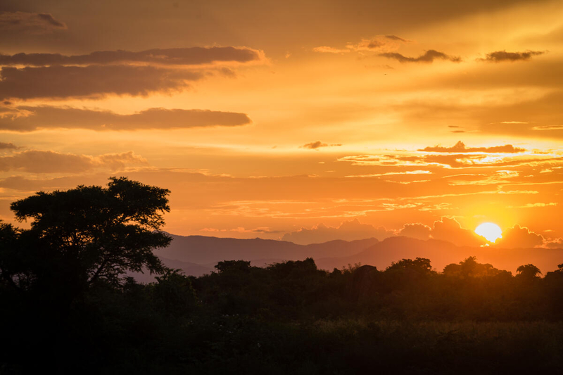 Sunset over landscape in Malawi, prone to droughts and floods
