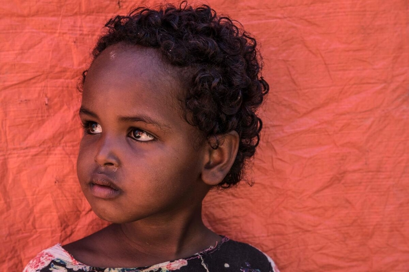 Young girl in Tigray, Ethiopia, where conflict is causing famine.