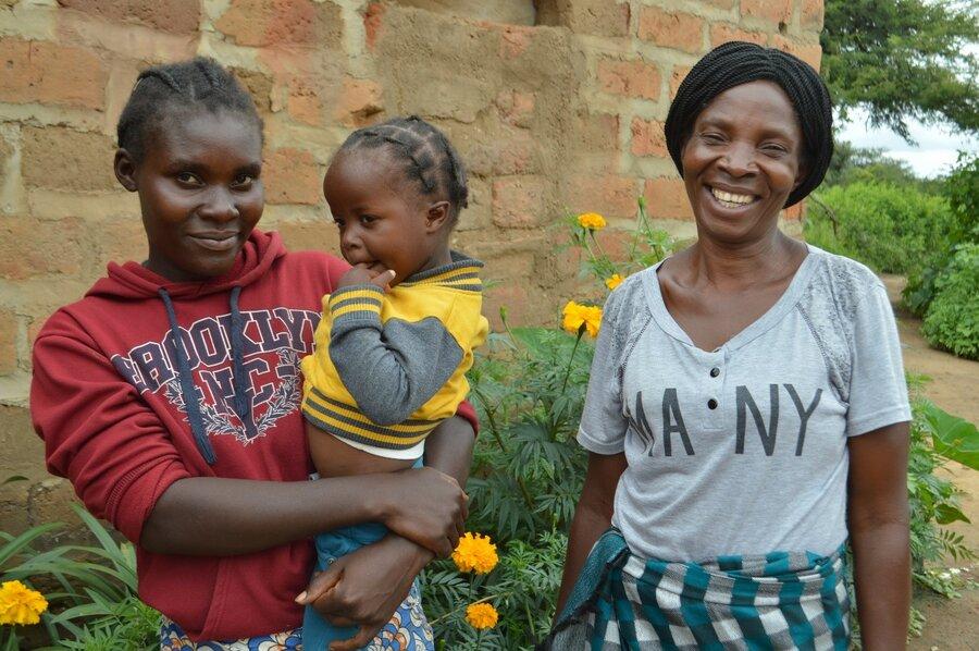 family smiles at camera