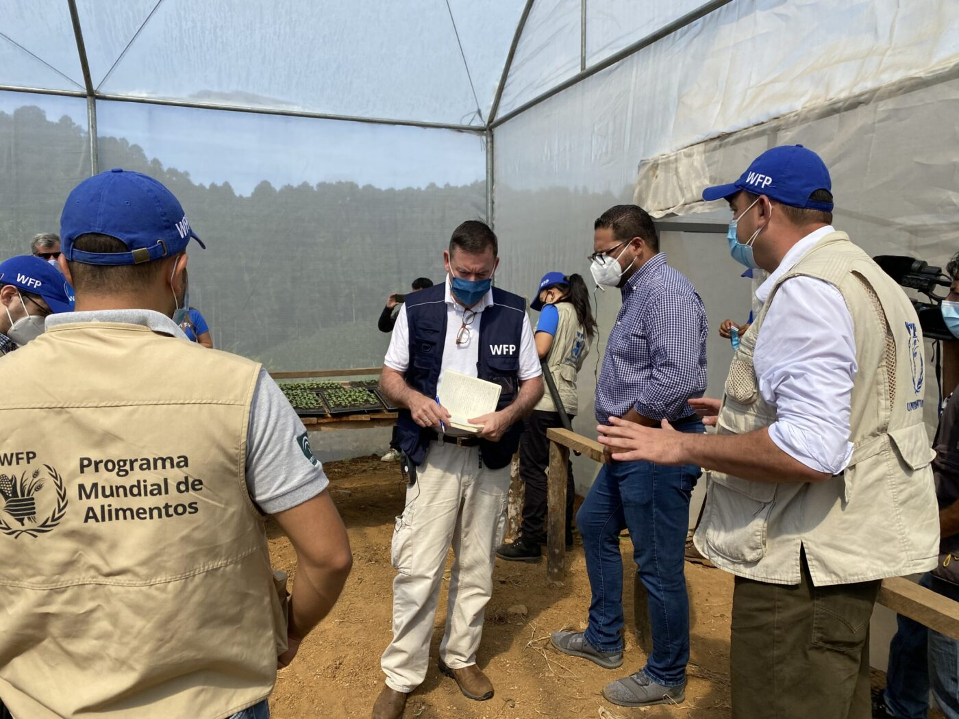 WFP USA president Barron Segar talks with other WFP staff in Central America
