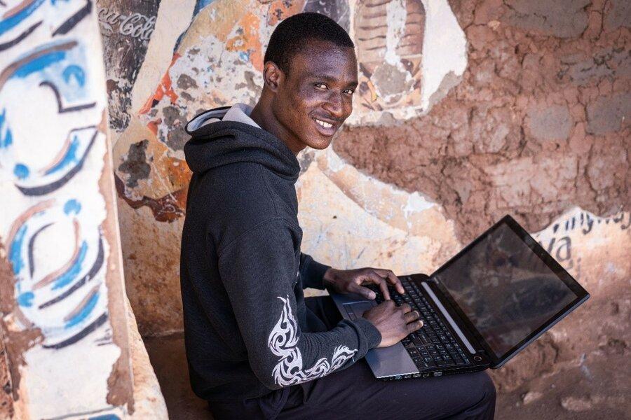 man in black hoodie on computer