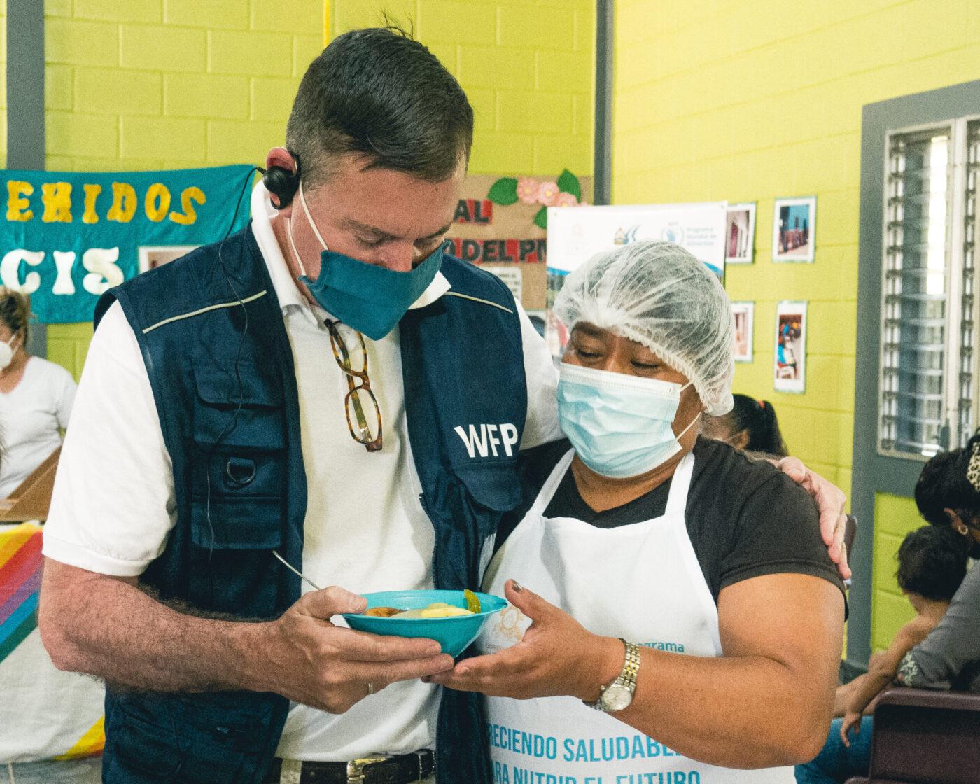 WFP USA president Barron Segar helps at food bank in Honduras
