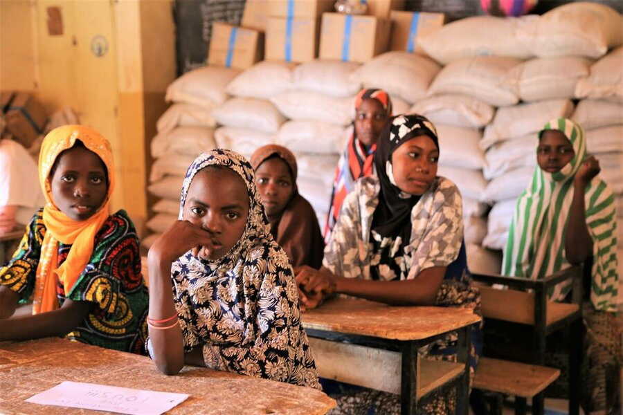 schoolgirls sitting in classroom