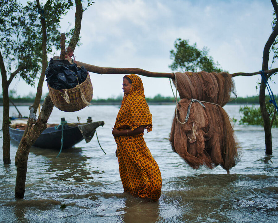 woman standing in flooded waters