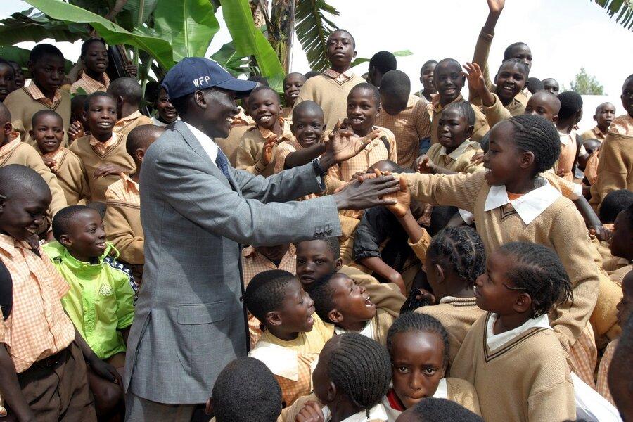 man in blue WFP hat speaking to crowd