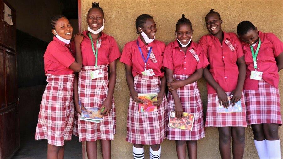 schoolgirls in red uniforms standing side by side