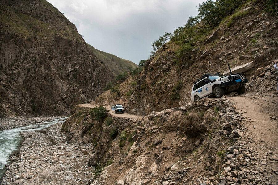 WFP trucks driving up rocky roads