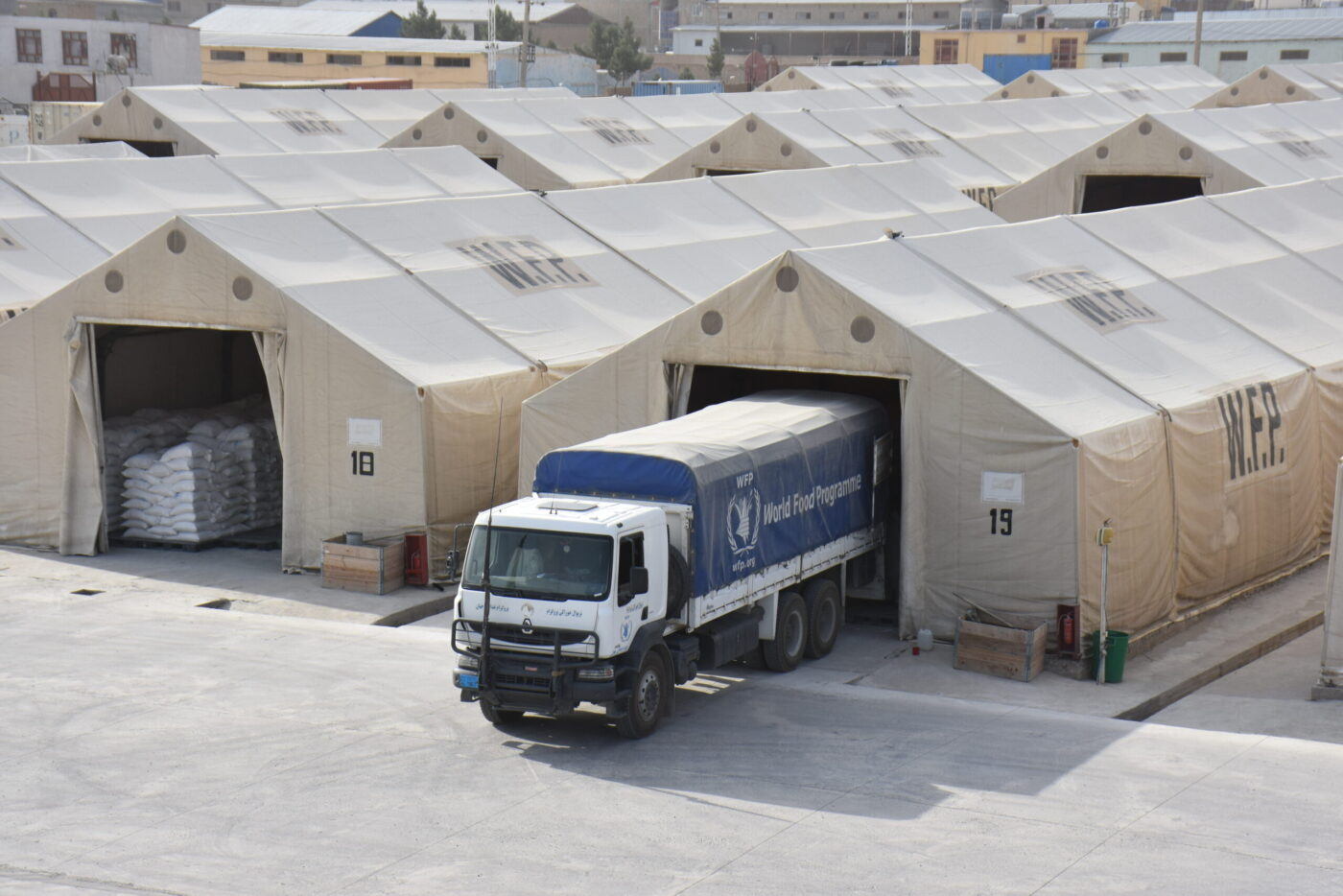 truck exiting a tent building