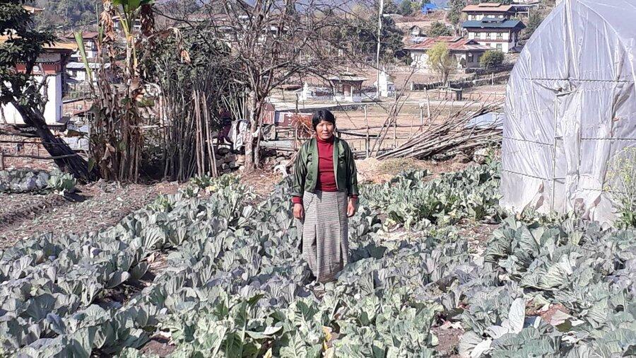 woman standing in field of crops
