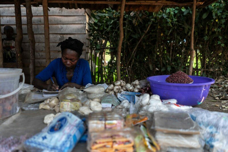 woman sitting behind her shop